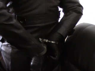 Sunday in leather coats: (Ballgagged and cuffed dominatrix with spunk on co