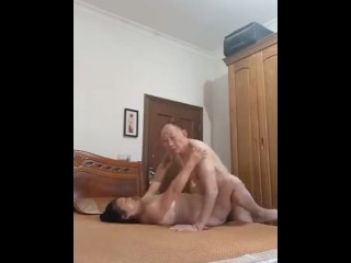 Asian grandmother and granddad enjoy