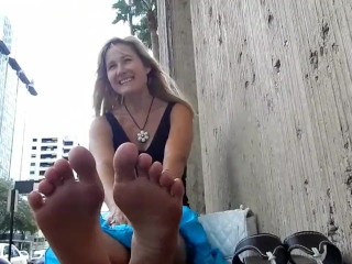 Blond cougar flashes soles