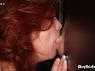 Gloryhole Secrets matured redhead swallows cum