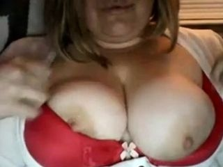Plump blond plays with plump fun bags on Chatroulette