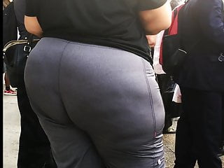 Broad plumper culo in Grey trousers