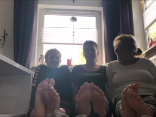 Mom and daughters-in-law showcase off their socks and barefeet