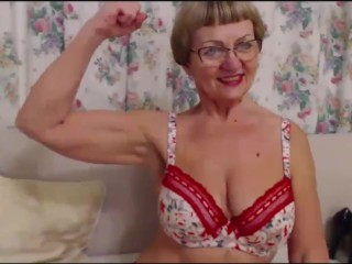 Grey super MILF flexes the brush biceps