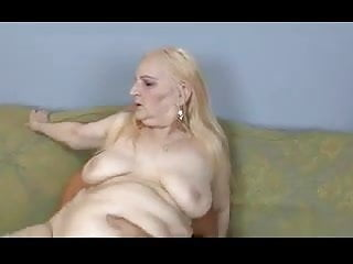 Light-haired grandma enjoys man rod