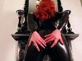 White-hot lubes prevalent their way latex catsuit coupled with rubs their way succulent soaked pussy