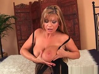 Mature mother with huge globes plows a faux-cock